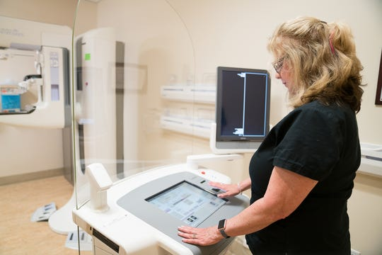 Radiologic Technologist Cheryl Reeves analyzes images from the 3D digital mammography system at Natividad's Care Center.