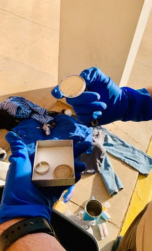 A San Angelo police officer sorts through hundreds of stolen items found in ongoing burglaries on Wednesday, Oct. 23.