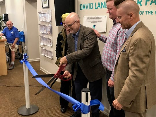 David Landsberger cuts a ribbon at the Chincoteague Island Family YMCA during a ceremony where the site was officially named to The David Landsberger Family YMCA on Oct. 21, 2019.
