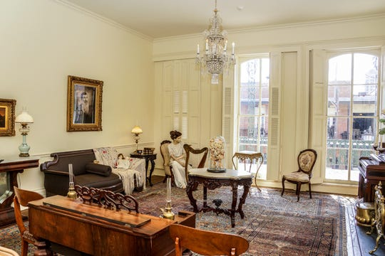 Spring Street Museum curators have recreated a typical 19th-century parlor with donated antique furniture, decorative items and china on the museum's second floor.