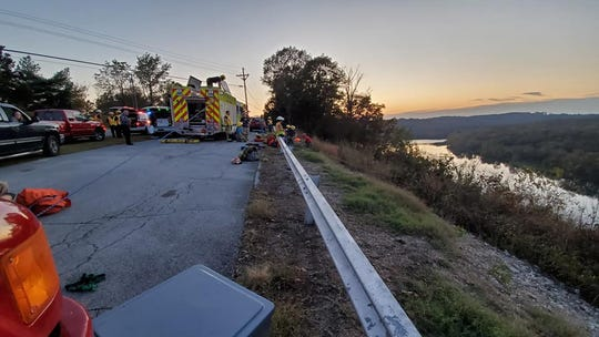 Three people crossed this scenic overlook guardrail and two then fell down the steep  cliff, where firefighters  rappelled down to save them.