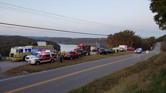 Fifteen firefighters were involved in getting two injured people down from a 350-foot tall cliff at the scenic overlook southwest of Forsyth.
