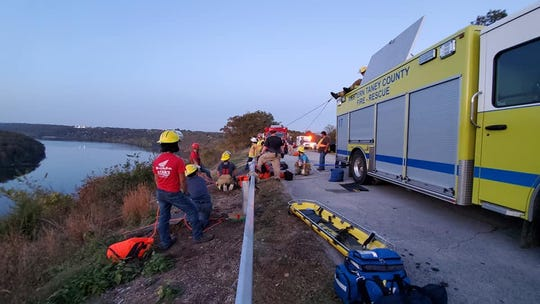 Firefighters from Western Taney County Fire Protection District connected a rescue rope to their fire truck during Sunday's rescue of two people from a cliff.