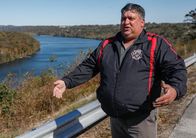 Chief Doug Bower, of the Central Taney County Fire Protection District, talks about the rescue of two people who fell off a cliff at a scenic overlook on State Highway Y in Forsyth, Mo.
