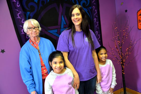 """Brenda """"Starfire"""" Stepp recently opened a metaphysical supply store called Starfire's Purple Moon Magick. Here she is pictured with her mother Mildred Stepp (far left) and her two twin daughters Leela (far right) and Kayla (front left)."""