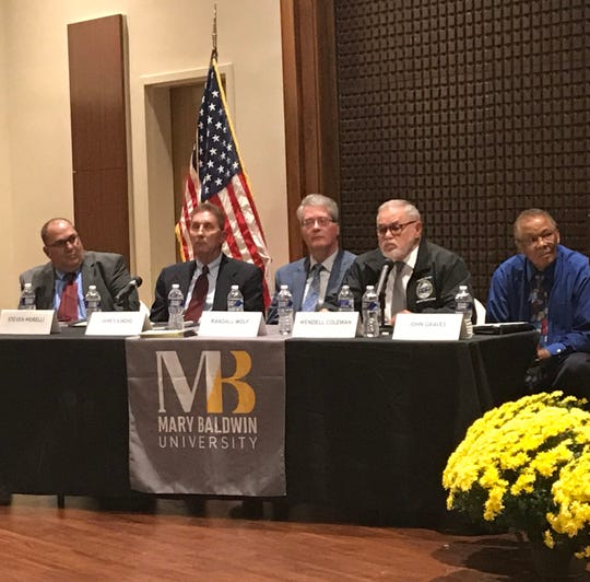 Candidates for the Augusta County Board of Supervisors pause to listen Tuesday night during a forum at Mary Baldwin University.