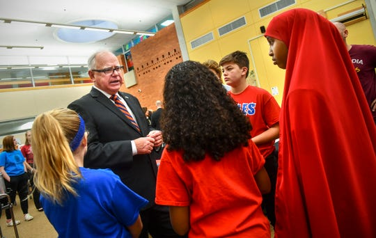 Minnesota Gov. Tim Walz talks with students after a roundtable discussion on subjects related to youth vaping Wednesday, Oct. 23, 2019, at North Junior High School in St. Cloud.