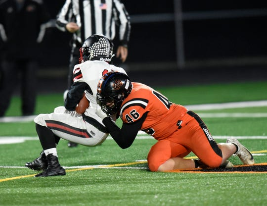 Tech senior Caleb Darnall makes a tackle against Monticello in the Section 6-5A quarterfinals Tuesday, Oct. 22, 2019, at Tiger Stadium.
