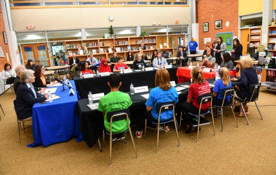 Students, staffers and Minnesota Gov. Tim Walz take part in a roundtable discussion on subjects related to youth vaping Wednesday, Oct. 23, 2019, at North Junior High School in St. Cloud.