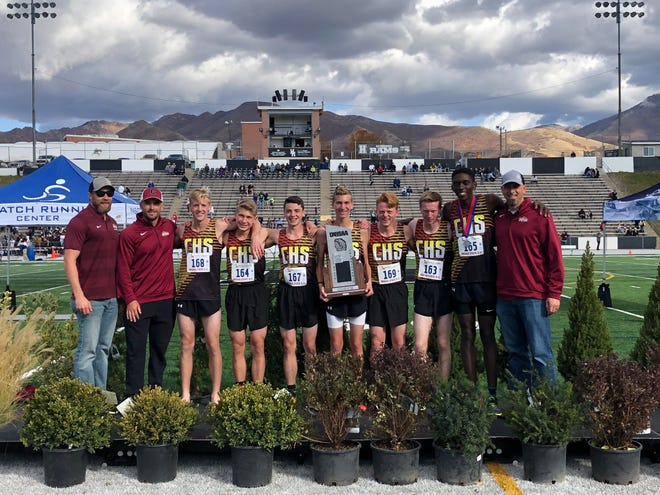 The Cedar boy's cross country team celebrates its second-place finish at the 2019 state cross country meet.