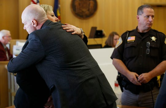 Jason Sypher hugs defense attorney Chelsie Thuecks after receiving a verdict on Wednesday, October 23, 2019, the Portage County Courthouse in Stevens Point, Wis. Sypher was convicted of murdering and hiding the body of his wife, Krista Sypher, who disappeared in March 2017 and has never been found.