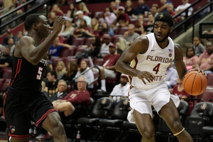Florida State Seminoles forward Patrick Williams (4) drives around a defender at the baseline during an exhibition game between FSU and Barry University at the Donald L. Tucker Civic Center Tuesday, Oct. 22, 2019.