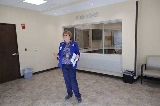 Polly White, senior vice president of clinical operations for Capital Health Plan, gives a tour of CHP's wound care ward inside the new Metropolitan Center Wednesday, Oct. 23, 2019.