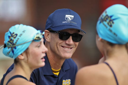 Community Christian swim coach Bob Horne talks to Chargers swimmers the District 1-1A swimming and diving meet at FSU's Morcom Aquatics Center on Tuesday, Oct. 22, 2019.