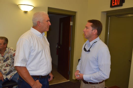 A Jefferson County Commissioner Stephen Walker talks to state Rep. Jason Shoaf.