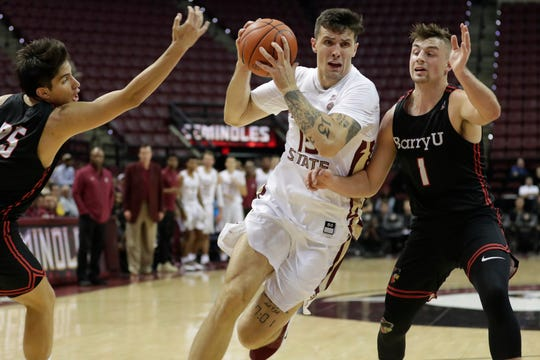 Florida State Seminoles center Dominik Olejniczak (15) drives between two defenders during an exhibition game between FSU and Barry University at the Donald L. Tucker Civic Center Tuesday, Oct. 22, 2019.