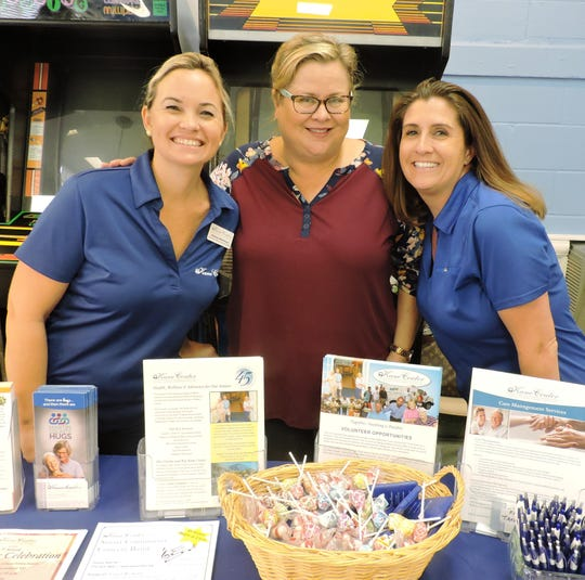 Chelsey Matheson, left, Jeanne Kenney and Jennifer Gore of the Kane Center attend the East Stuart Community Health Fair at the 10th Street Complex on  Oct. 12, 2019.