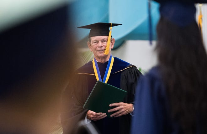 Indian River College President Edwin Massey hands out diplomas during the Clark Advanced Learning Center graduation commencement ceremony Saturday, May 25, 2019, at Jensen Beach High School. Virtual forums with the final three candidates to replace Massey are to be conducted Tuesday, Wednesday and Thursday.