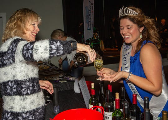 Vero Beach City Clerk Tammy Bursick, left, who also is co-chair of the Vero Vino Wine & Food Festival,  serves Ms. Vero Beach Centennial Anna Valencia Tillery at the 2018 festival. The 2019 festival is 4 to 6 p.m. Nov. 23 at the Vero Beach Heritage Center. Visit verovinofestival.com for details.