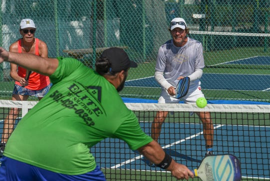 Pickleball University members from across the Treasure Coast enjoy a day of pickleball matches on Tuesday, Oct. 22, 2019, on the courts at Pocahontas Park in Vero Beach. Pickleball is a paddleball sport that combines elements from tennis, badminton, and table tennis (ping pong) played using a whiffle ball on a badminton-sized court and a tennis style net.