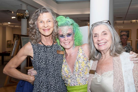 "Director of Exhibitions Georgina Love, left, ""Halloween Glamour"" Ashley DeWitt and Board President Janie Hinkle at the 2019 Juried Art Exhibition ""The Best of the Best"" at the Backus Museum in Fort Pierce."