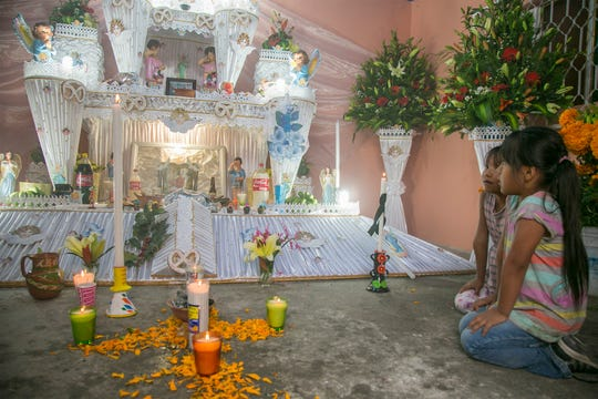 Photographer Ann Murdy captured the bright colors and aromas of ofrendas or altars to the dead in her book.