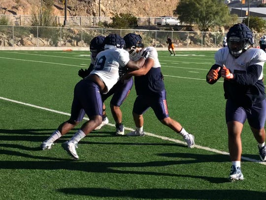UTEP nosetackle Chris Richardson (99) competes in a drill Wednesday at Glory Field