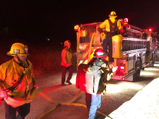Firefighters responded to a vegetation fire Tuesday night in Santa Paula. The blaze was in the river bottom of Santa Paula Creek.