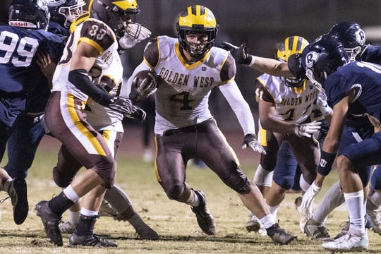 Golden West's Lonnie Wessel runs against in a West Yosemite League high school football game on Friday, October 11, 2019.