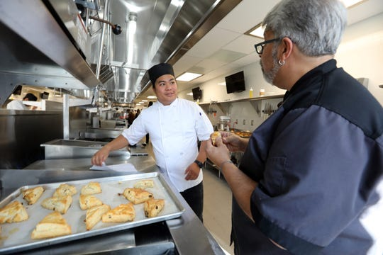 Student Chris Nguyen shows his sweet scones to Cris Spezial, chair, Hospitality and Culinary Arts at the Rockland Community College Culinary Arts Center in Nyack Oct. 23, 2019.