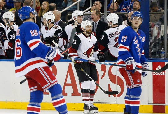 Oct 22, 2019; New York, NY, USA; Arizona Coyotes left wing Lawson Crouse (67) is congratulated after scoring a goal as New York Rangers center Ryan Strome (16) and right wing Jesper Fast (17) react during the second period at Madison Square Garden.