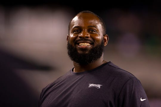 Fletcher Cox #91 of the Philadelphia Eagles laughs from the sidelines in the third quarter against the Tennessee Titans in the preseason game at Lincoln Financial Field on August 8, 2019 in Philadelphia, Pennsylvania. The Titans defeated the Eagles 27-10.