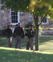 Police investigate a shooting Wednesday morning on Parkman Court.