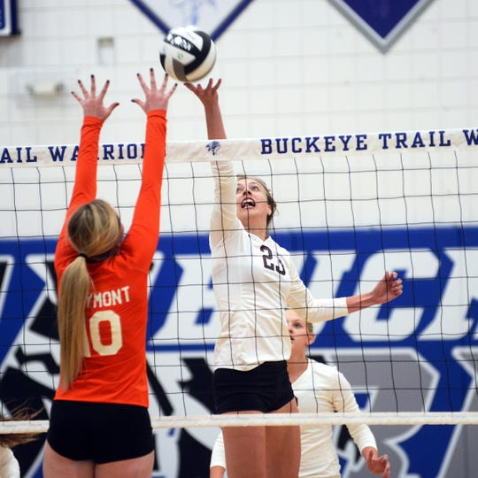 Lyndi Slack plays the ball at the net during the first set of John Glenn's 25-14, 25-10, 25-14 win against Claymont in a Division II district semifinal on Tuesday in Old Washington.