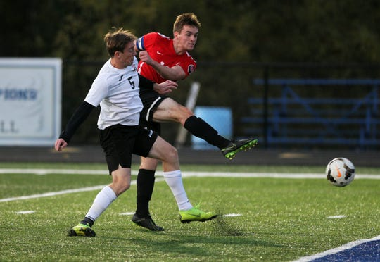Rosecrans' Weston Nern takes a shot against Coshocton. Weston Nern had two goals in Rosecrans' 5-3 win over Coshocton in Tuesday's Division III boys soccer district semifinal at West Muskingum.
