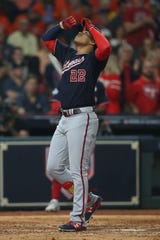 Nationals left fielder Juan Soto touches home plate after his homer in the fourth inning.