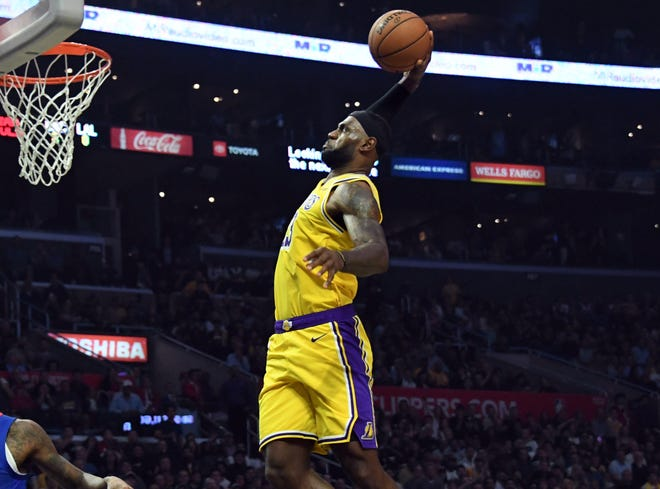 Oct. 22: Lakers forward Lebron James soars to the bucket for the one-handed slam against the Clippers.