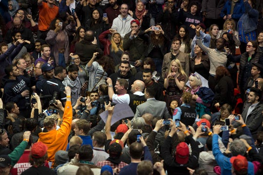 Anti-Donald Trump protesters and his supporters confront during a Trump rally at the UIC Pavilion in Chicago on March 11, 2016.