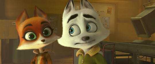 "Swifty the Arctic Fox (voiced by Jeremy Renner, right) enlists the help of his brainy engineer friend Jenny (Heidi Klum) to stop an evil genius from world domination in the animated comedy ""Arctic Dogs."""