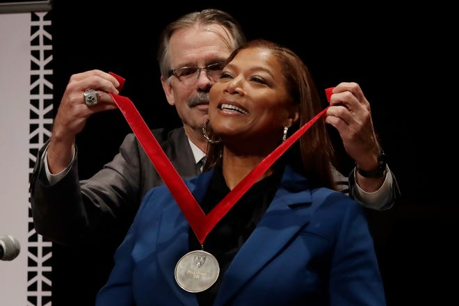 Music artist and actress Queen Latifah receives the W.E.B. Dubois Medal for her contributions to black history and culture from Glenn H. Hutchins during ceremonies at Harvard University, Tuesday, Oct. 22, 2019, in Cambridge, Mass.