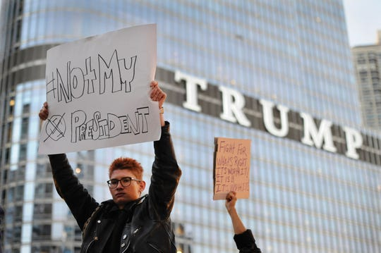 People take part in a protest near the Trump tower, against President-elect Donald Trump, in Chicago, Illinois on November 9, 2016.