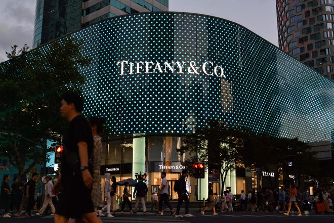 People walking past a Tiffany store in Shanghai.