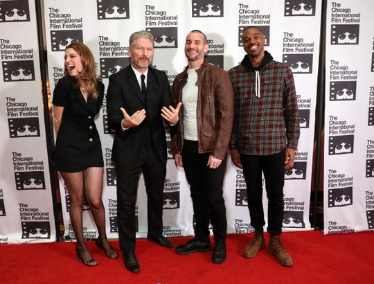 "Sarah Brooks, Travis Stevens, Phil ""CM Punk"" Brooks and Travis Delgado attend the red carpet Premiere of ""Girl on the Third Floor"" at the Chicago International Film Festival on Oct. 18, 2019 in Chicago, Illinois."