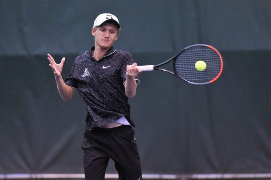 Abilene High's Ryan Flanagan hits a shot during the mixed doubles match against Flower Mound Marcus in the Region I-6A semifinals at the Fairway Oaks indoor courts on Oct. 24. Flanagan and partner Cassie Hernandez won 6-0, 6-0.