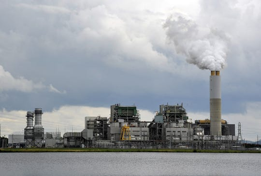 "Duke Energy's existing Lake Julian plant mostly burns coal to generate electricity, but it will switch to natural gas later this year. After the switch, the 320-foot tall ""scrubber"" smokestack for the coal-burning operation will be demolished in 2020."