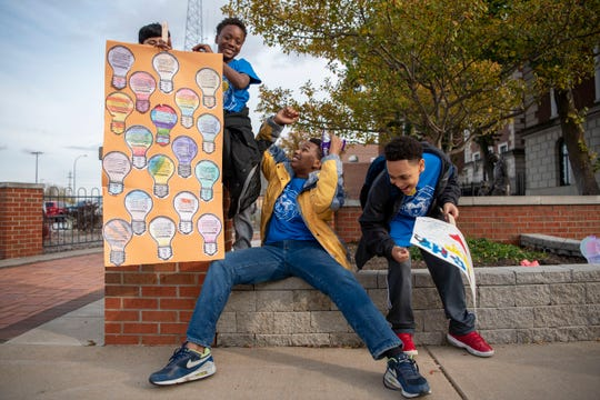 "Students from all nine sites of BCPS' 21st century program advocate for their after-school programs by chanting ""keep the lights on"" on Thursday, Oct. 24, 2019 in downtown Battle Creek, Mich."