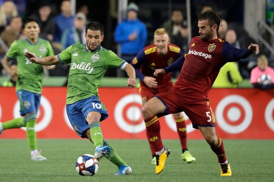 Seattle Sounders forward Nicolas Lodeiro, left, is challenged by Real Salt Lake midfielder Kyle Beckerman (5) during the first half of an MLS Western Conference semifinal playoff soccer match Wednesday, Oct. 23, 2019, in Seattle.