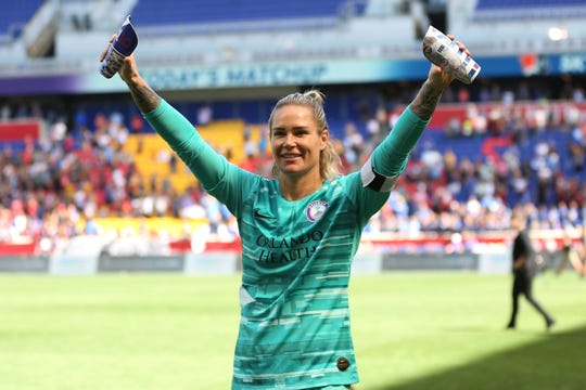 Orlando Pride goalkeeper Ashlyn Harris (24) acknowledges the crowd after an NWSL soccer match against Sky Blue FC, Sunday, Sept. 29, 2019, in Harrison, N.J. The match ended in a 1-1 draw. (AP Photo/Steve Luciano)