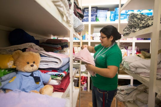 Peal Zamora, a resident advocate, gathers linens for a family that had refuge at the Women's Shelter of South Texas in June 2015.