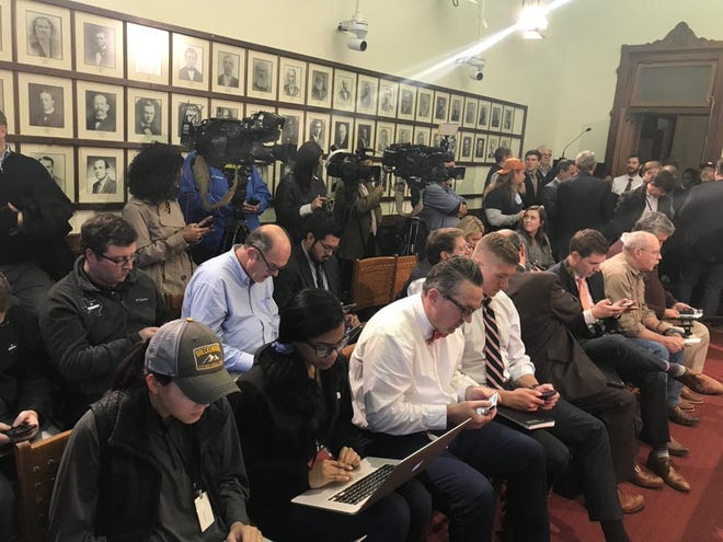 Reports from the Texas Capitol press corps during a news conference in room adjacent to the House chamber.